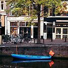 Blu Boat - Amsterdam by Larry Costales