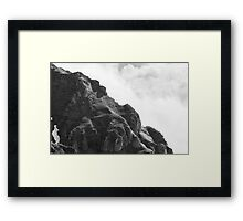 the sound of rocks in clouds Framed Print