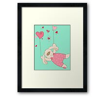 Rabbit flying with heart balloons  Framed Print
