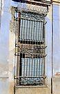 Shuttered & barred window , Cuba by buttonpresser
