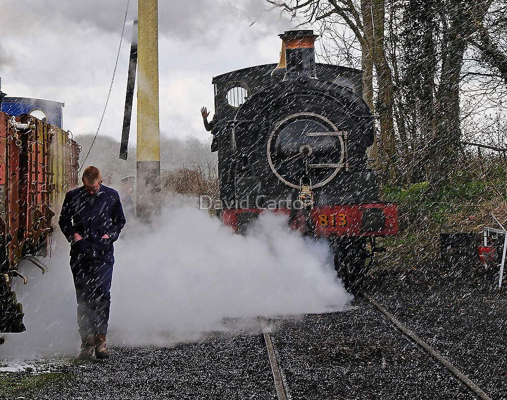 Engineer walking through steam from locomotive in snowy sidings by buttonpresser
