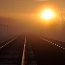 Foggy sunrise over the railroad tracks by mltrue