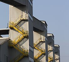 industrial towers (with yellow stairs) by fabio piretti