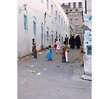 Symbols on the wall (2) - a street in old Al Mukalla Photographic Print
