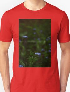 Tiny blue flowers amongst the green T-Shirt