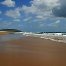 Looking down the beach by footsiephoto