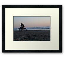 Bikers watching sunset Framed Print
