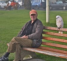 A man with his avian friend by davridan