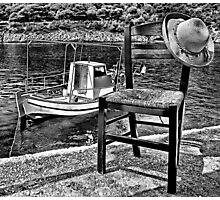 Boat with chair and hat in Kefalonia Photographic Print