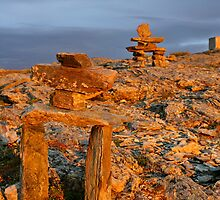 Two Inukshuk's in golden glow of sunset by Rob vanNostrand