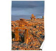 Two Inukshuk's in golden glow of sunset Poster