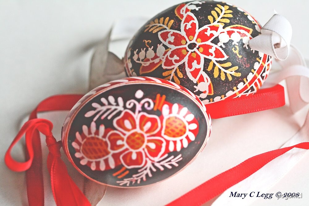 Two traditional black Czech Easter eggs with hand-painted geometric designs by pogomcl