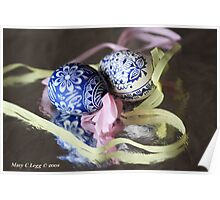two traditional hand-painted Czech blue and white Easter eggs reflect on silver foil Poster