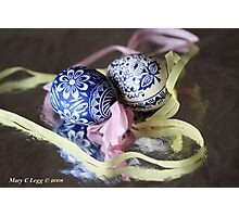 two traditional hand-painted Czech blue and white Easter eggs reflect on silver foil Photographic Print