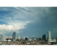 A tropical storm moves over the city Photographic Print