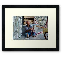 Fisherman fixing net in Monterosso, Cinque Terre, Italy Framed Print
