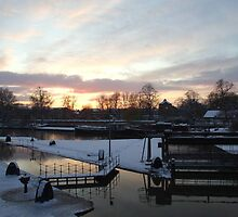 Snowy Weir At Sunset by Malky-C