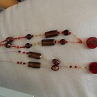 naomi and zeerak's red / brown / gold necklaces by sylversorceress