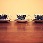tea in teacups by rachelwalker
