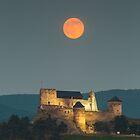 The castle of Boldogko at full moon by Gabor Pozsgai