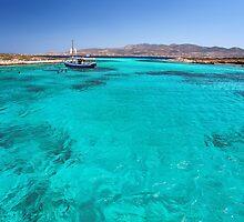 Blue lagoon in Antiparos islands, Greece by Lemonan