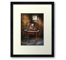 Artist - The etching table Framed Print