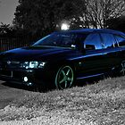 Black Holden Commodore wagon at night. by Ferenghi