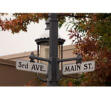 Street signs in a small town Photographic Print
