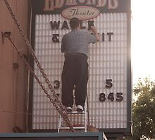 Changing the theatre sign by hand by Carlanne McCrystal