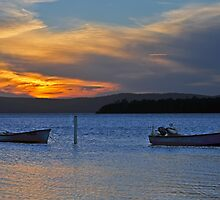 Boats at rest at sunset by bazcelt