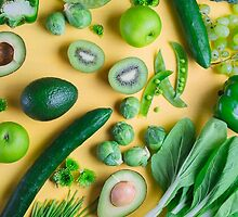 Green food on yellow background by Alita  Ong