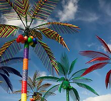 Plastic Palm Trees against Blue Sky by Stacey Lynn Payne