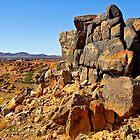 Rocky outcrop above the Kalahari desert by Rudi Venter