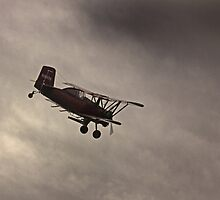 Crop Duster Flying in Stormy Skies by Buckwhite