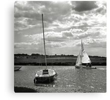 A yacht returns to harbour at Blakeney, Norfolk, UK Canvas Print