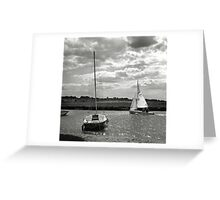 A yacht returns to harbour at Blakeney, Norfolk, UK Greeting Card