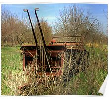 Antique farm equipment left to the elements Poster