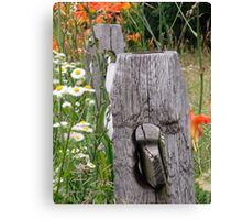 Tiger lilies on rail fence Canvas Print