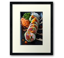Sushi awaiting death by mouth Framed Print