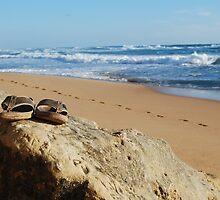 Desolate relaxing beach with flipflops by David Duggan