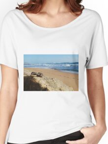 Desolate relaxing beach with flipflops Women's Relaxed Fit T-Shirt