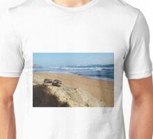 Desolate relaxing beach with flipflops Unisex T-Shirt
