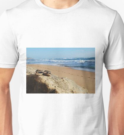 Desolate relaxing beach with flipflops Unisex T-Shirt