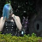 Girl w/ blue hair-Jackson Square-New Orleans by milton ginos