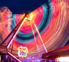 Fairground round at night by swhite99