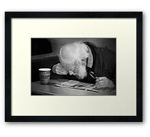 Man reading paper Framed Print