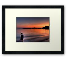 The boy and the sea Framed Print