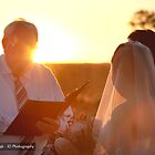 Sunrise wedding at Ayers Rock by idphotography