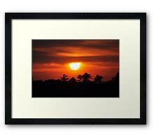 sunset through the clouds Framed Print