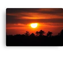 sunset through the clouds Canvas Print